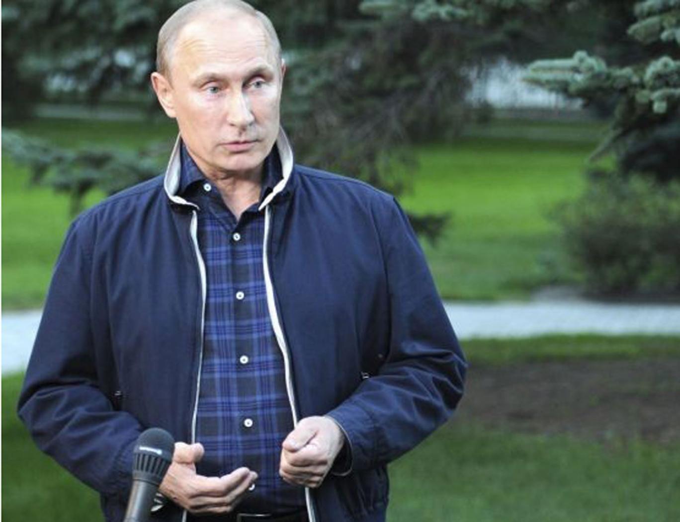 Russia's President Vladimir Putin talks to journalists in the far eastern city of Vladivostok