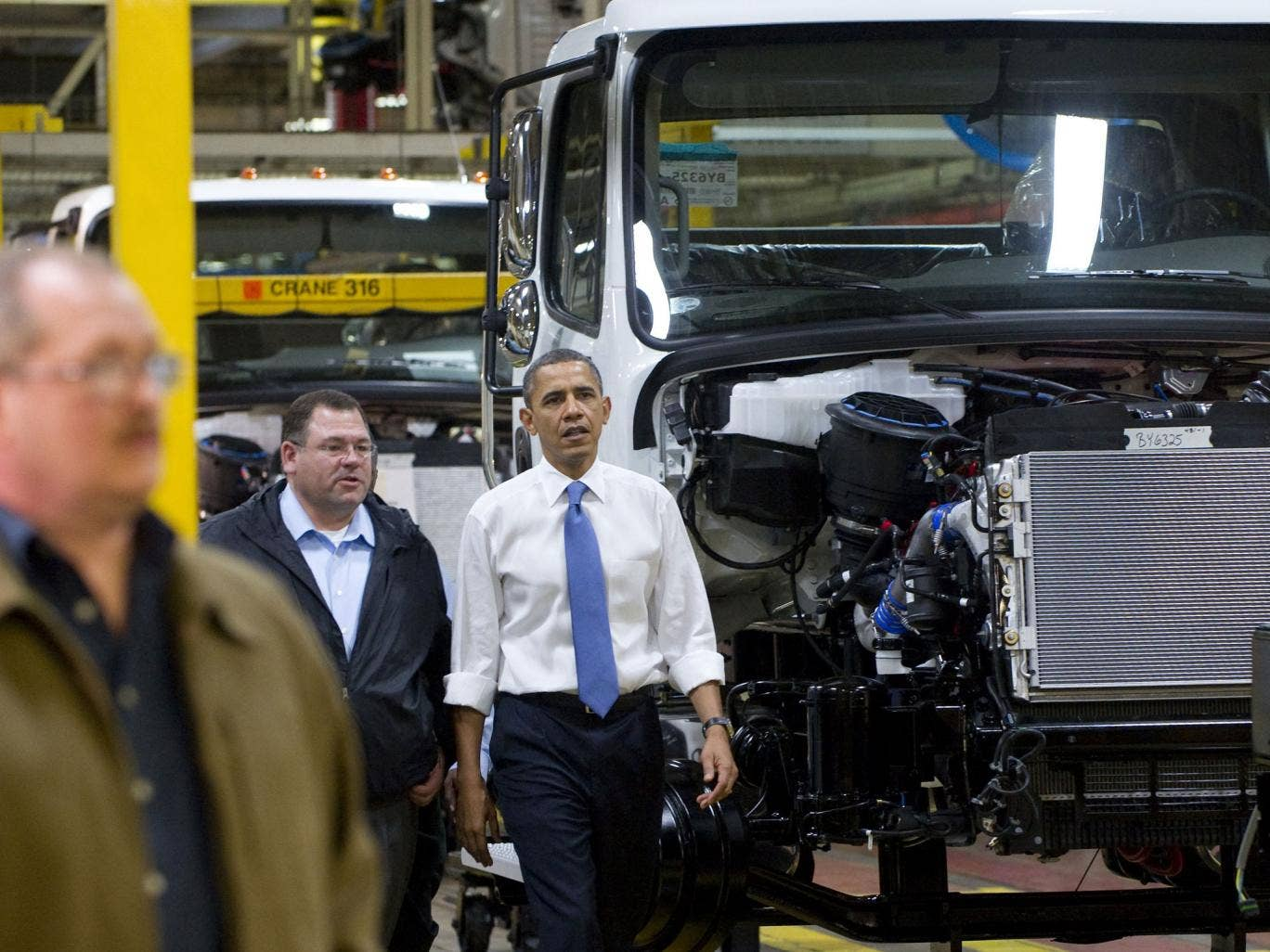 President Obama, here touring a truck factory, will soon have to turn his attention to the US economy
