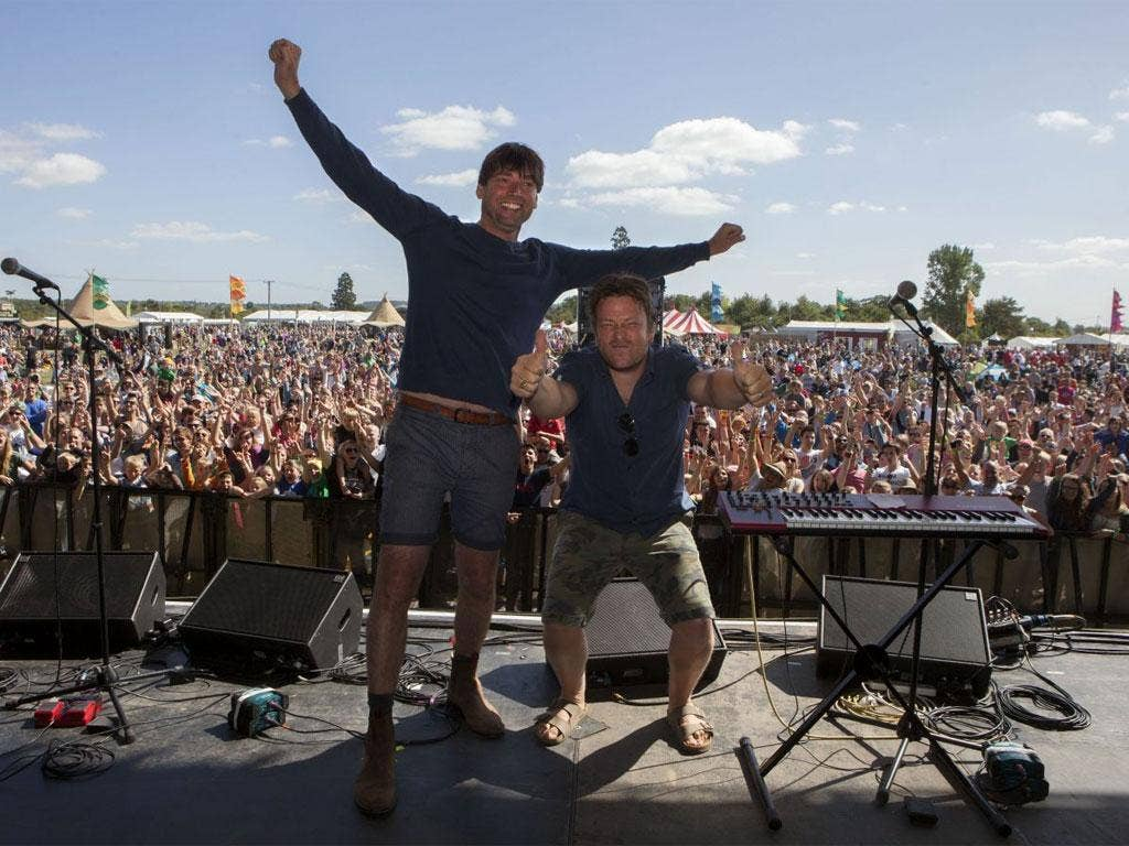 Alex James and Jamie Oliver, pictured in front of the crowd, invite traders such as Neal'sYard, to feed the middle-class masses over the two day festival