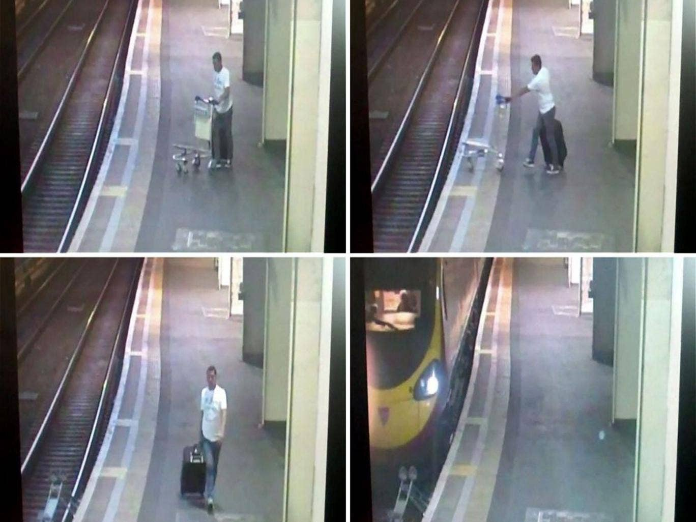 Handout CCTV grabs issued by British Transport Police of a man pushing a suitcase trolley onto the tracks at Euston station in London.