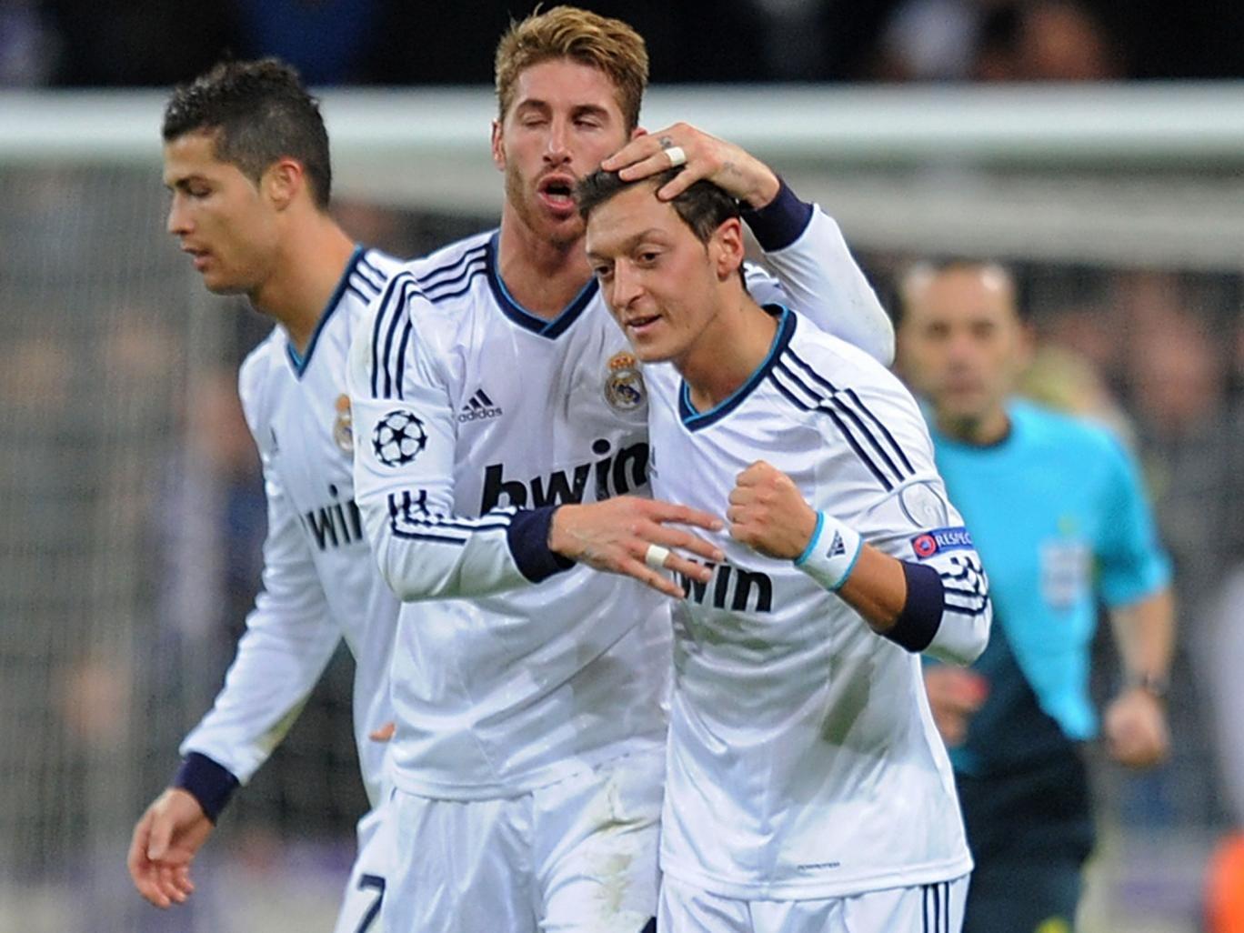 Sergio Ramos celebrates with Mesut Ozil