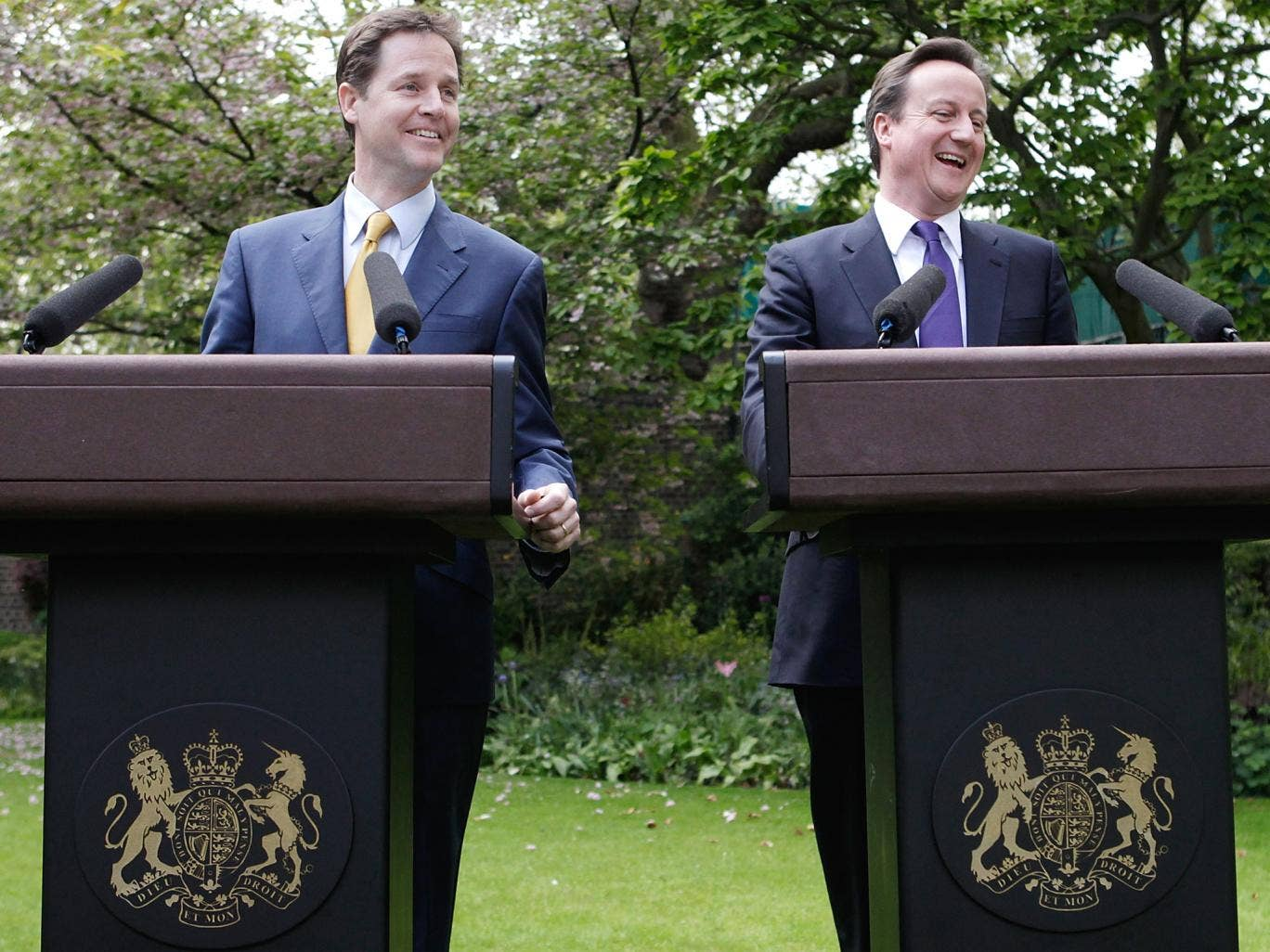 Nick Clegg and David Cameron: Their ties showed party colours, but the PM and his deputy otherwise matched outfits in the heady days of the Coalition honeymoon. They wore navy suits during their garden press conference in 2010, but have taken more individ