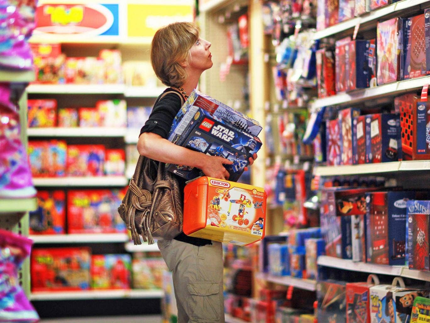 A shopper browses a Toys R Us store