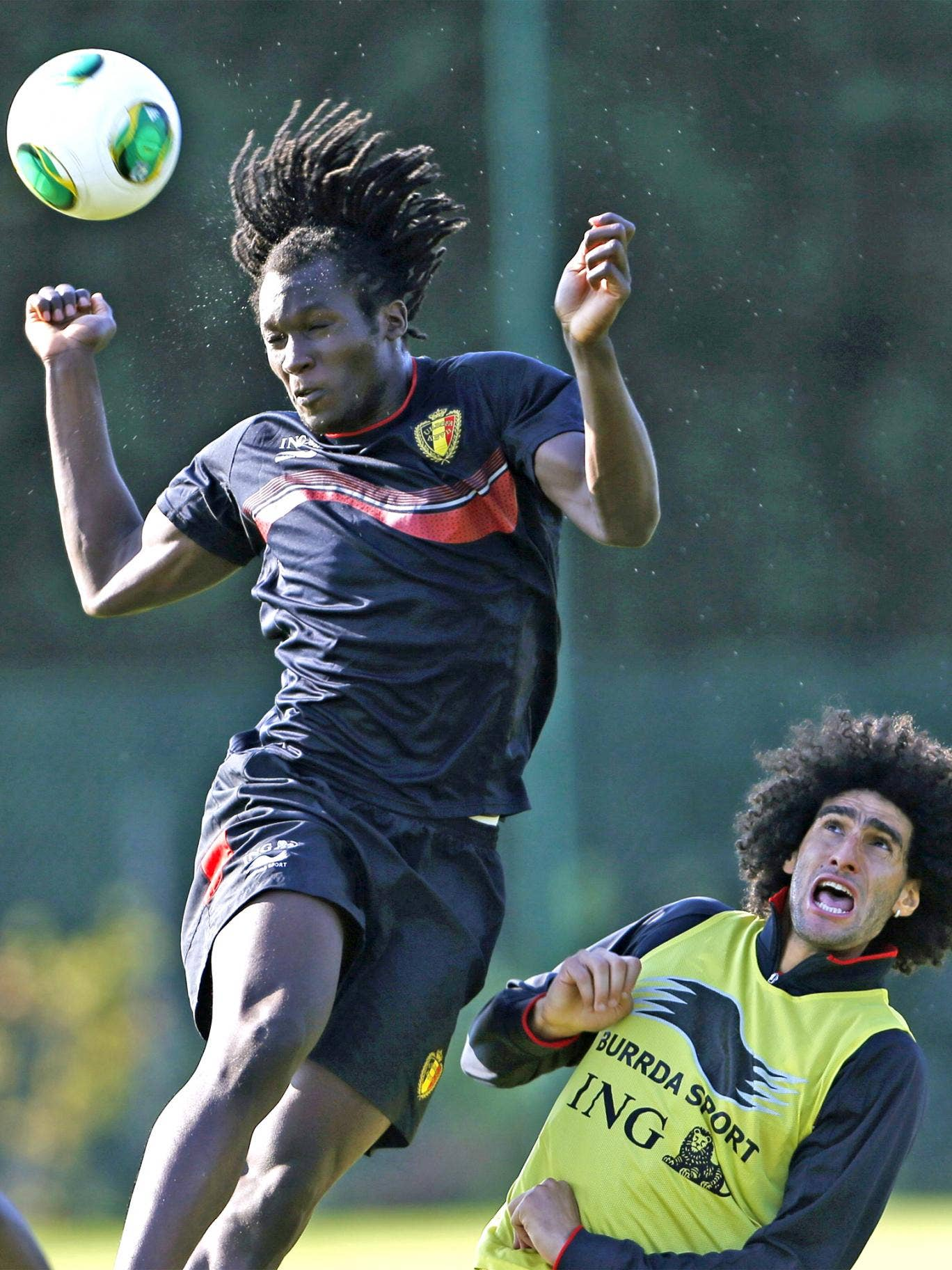 Romelu Lukaku (left) and Marouane Fellaini take part in a training session in Brussels ahead of Belgium's game against Scotland