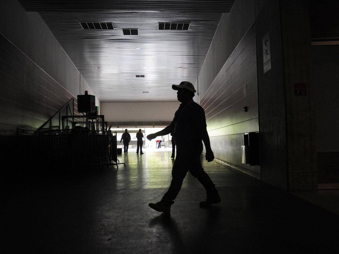 A man walks at the Poliedro stadium in Caracas