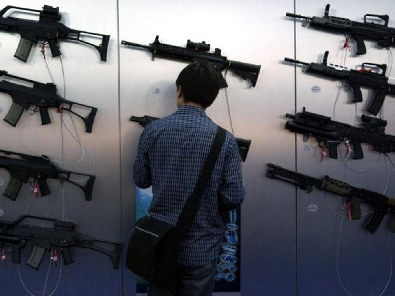 Guns for sale: Browsing at a previous DSEi arms show