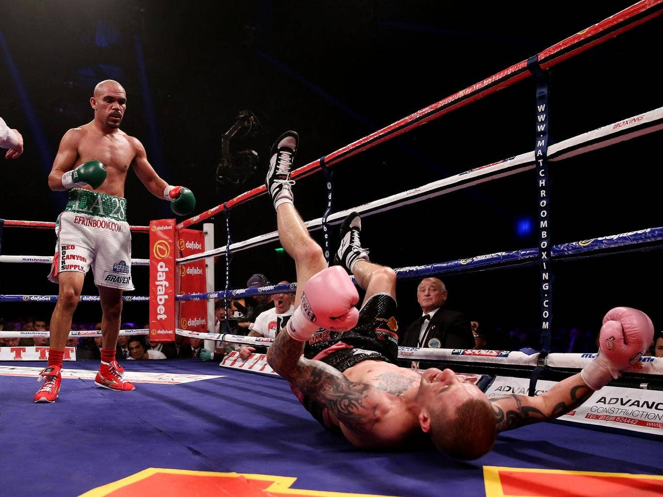 Ricky Burns is floored by Ray Beltran in the eighth round in Glasgow