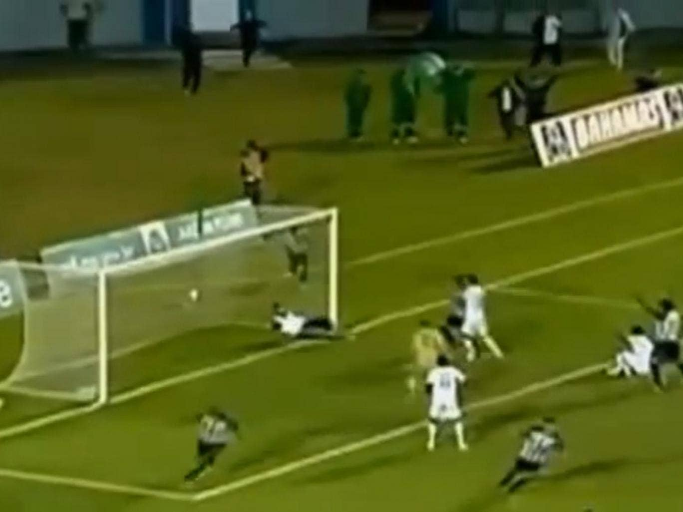 A Brazilian football team masseur runs onto the pitch to save a last-minute shot in a semi-final playoff