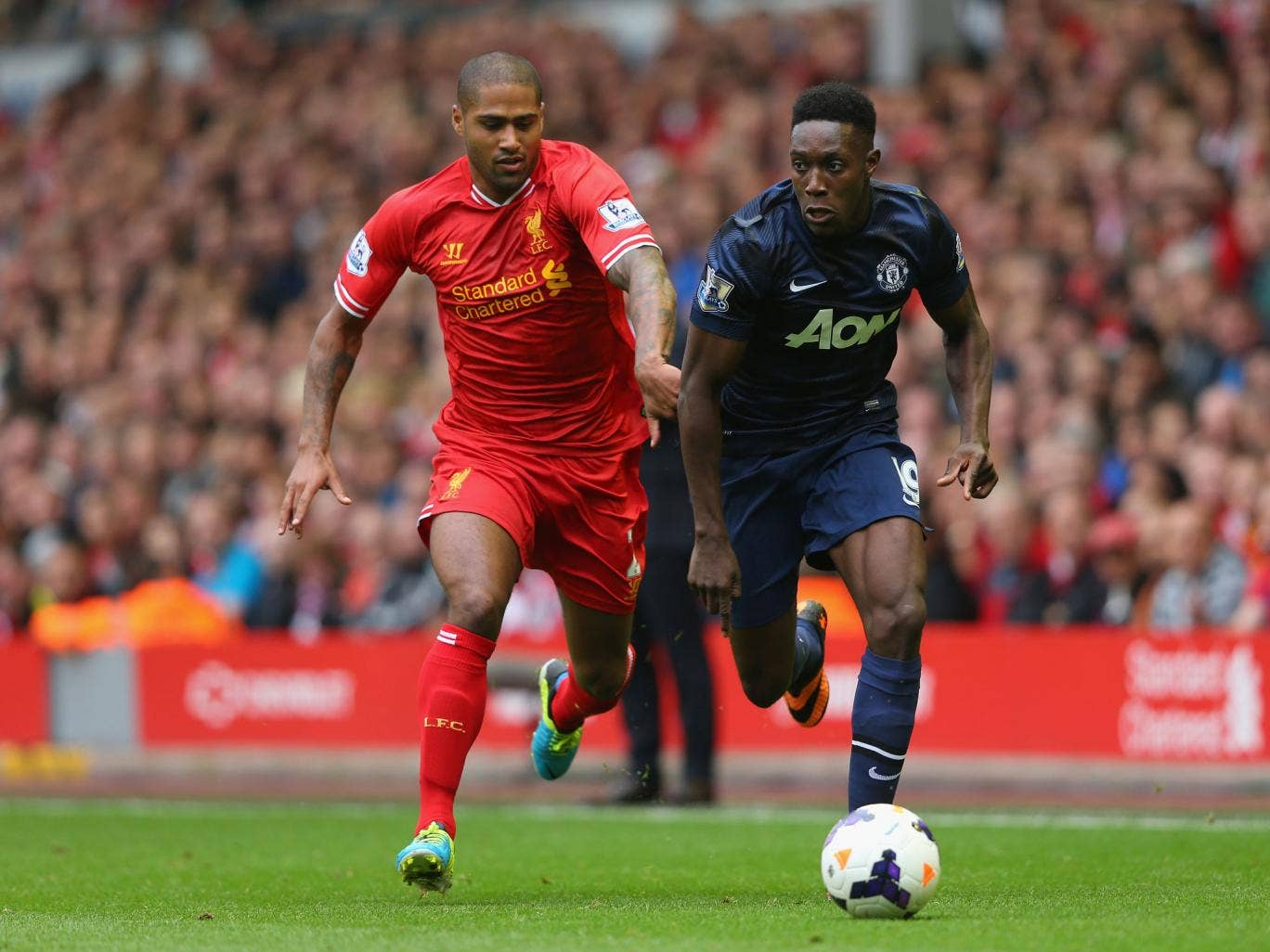 Glen Johnson of Liverpool challenges Manchester United's Danny Welbeck