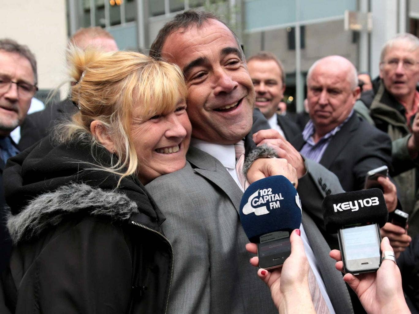 Michael Le Vell is embraced by friends as he makes a statement to the press after being found not guilty