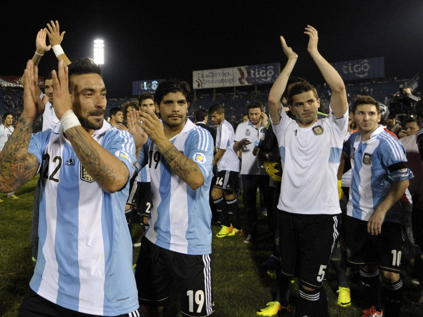 Lionel Messi celebrates World Cup qualification with his team-mates