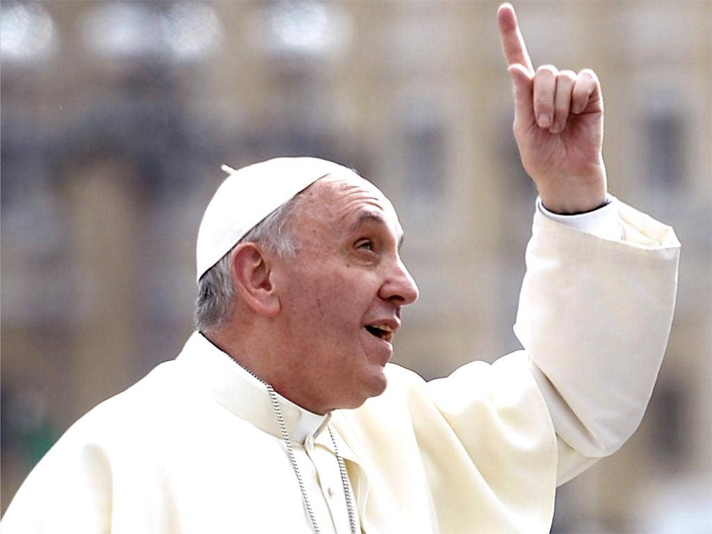 Pope Francis gestures upon his arrival in St Peter's square