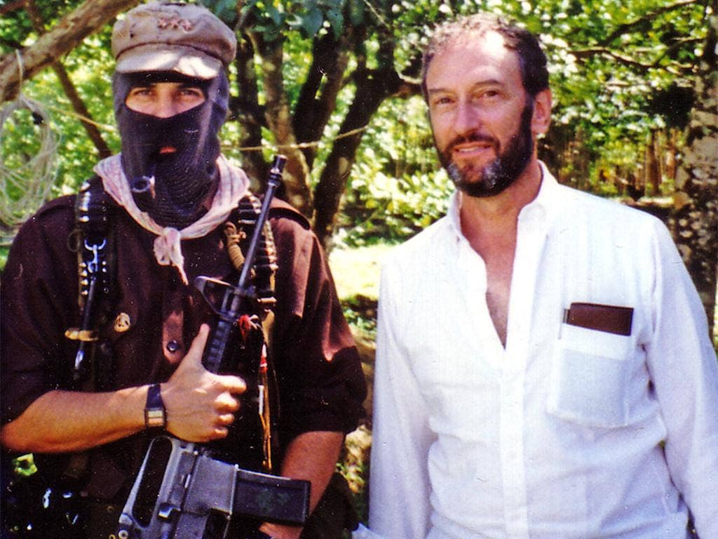 Saul Landau with a Mexican Zapatista