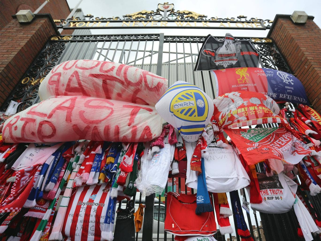 Tributes at Anfield's Shankly Gates following the publication of the Hillsborough report last year