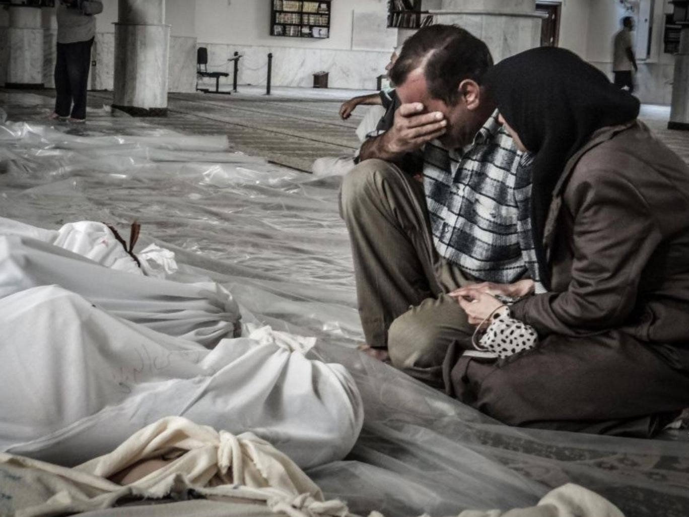 Victims: Parents grieve for their child, gassed in Ghouta