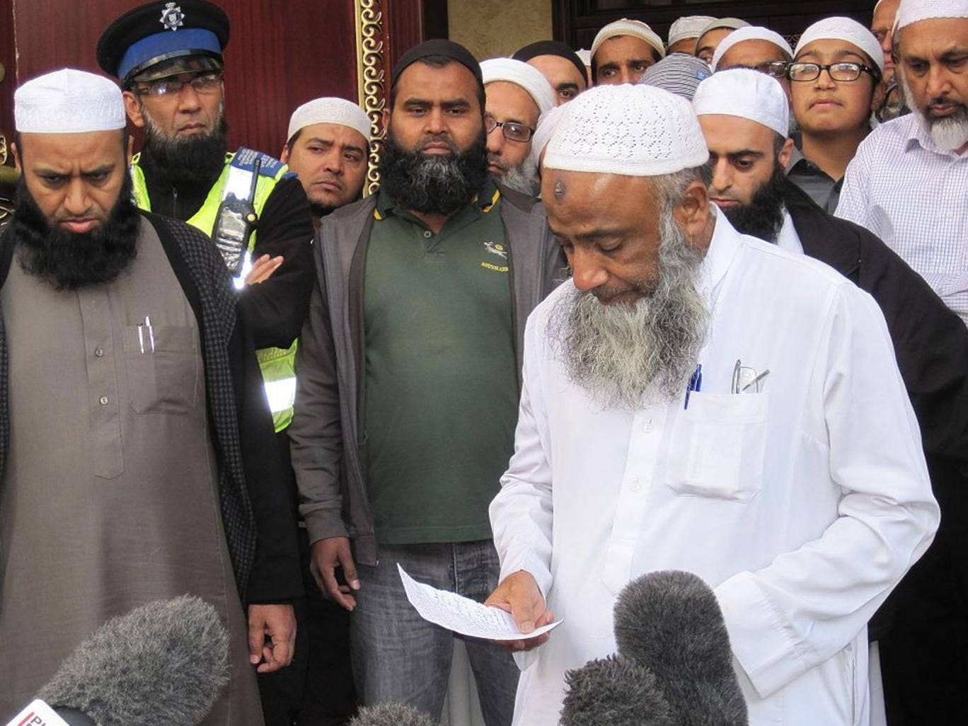 Muhammad Taufiq al-Sattar pays tribute to his wife and children who died in the fire