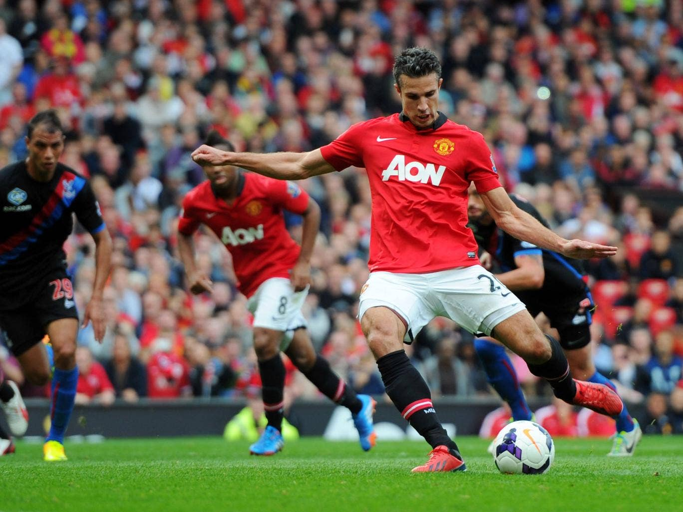 Robin van Persie scores from the penalty spot against Crystal Palace on Saturday