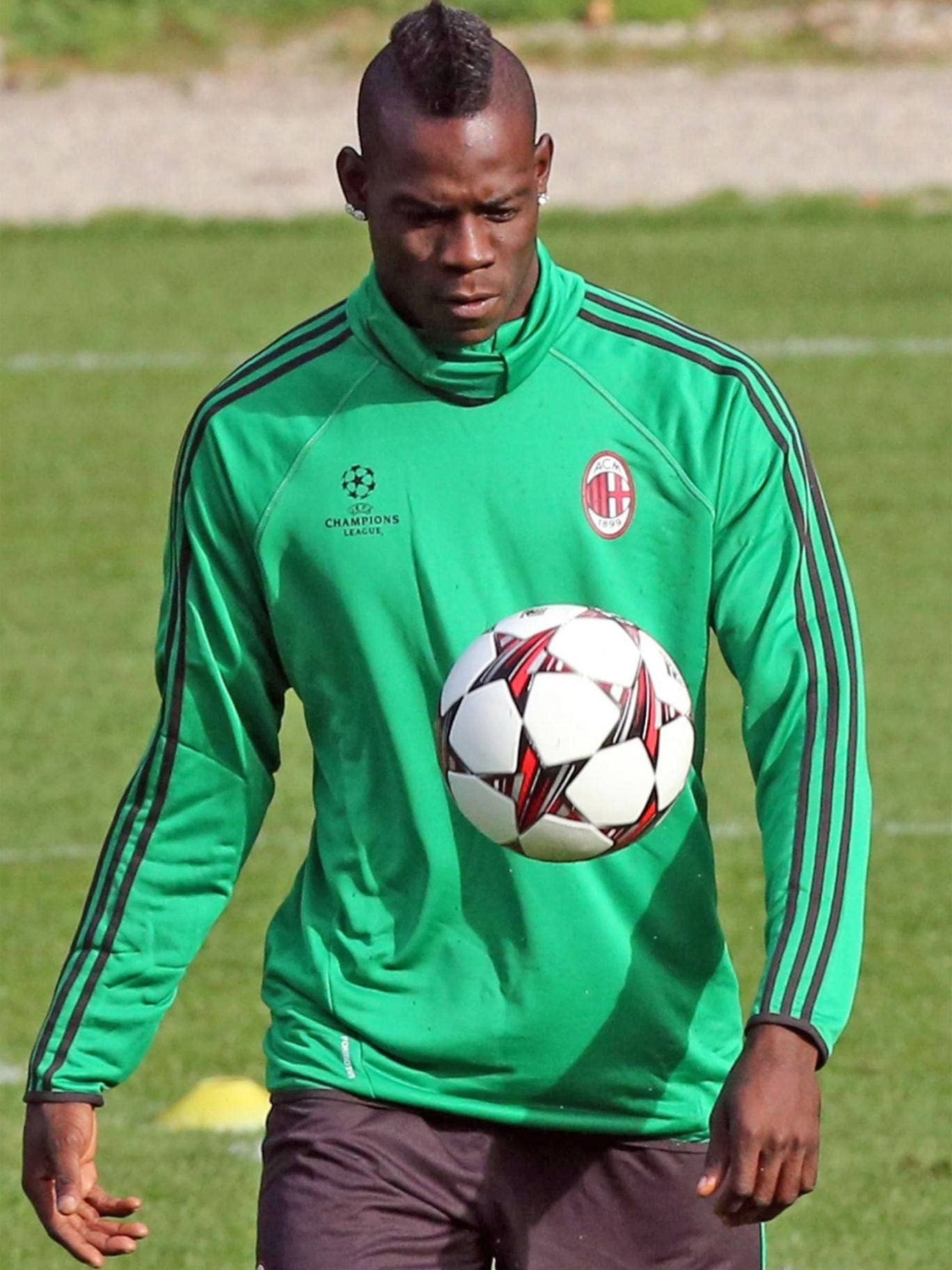 Mario Balotelli trains ahead of Milan's Champions League tie with Celtic