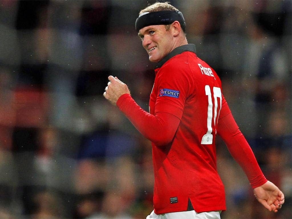 Wayne Rooney is delighted with his own form but wouldn't reveal if he is happy as a United player
