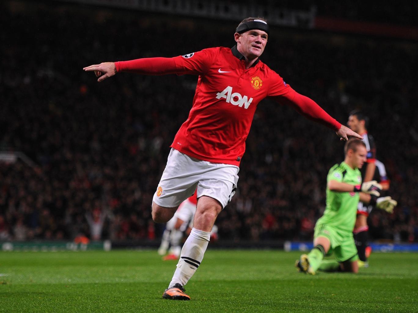 Wayne Rooney celebrates scoring against Bayer Leverkusen