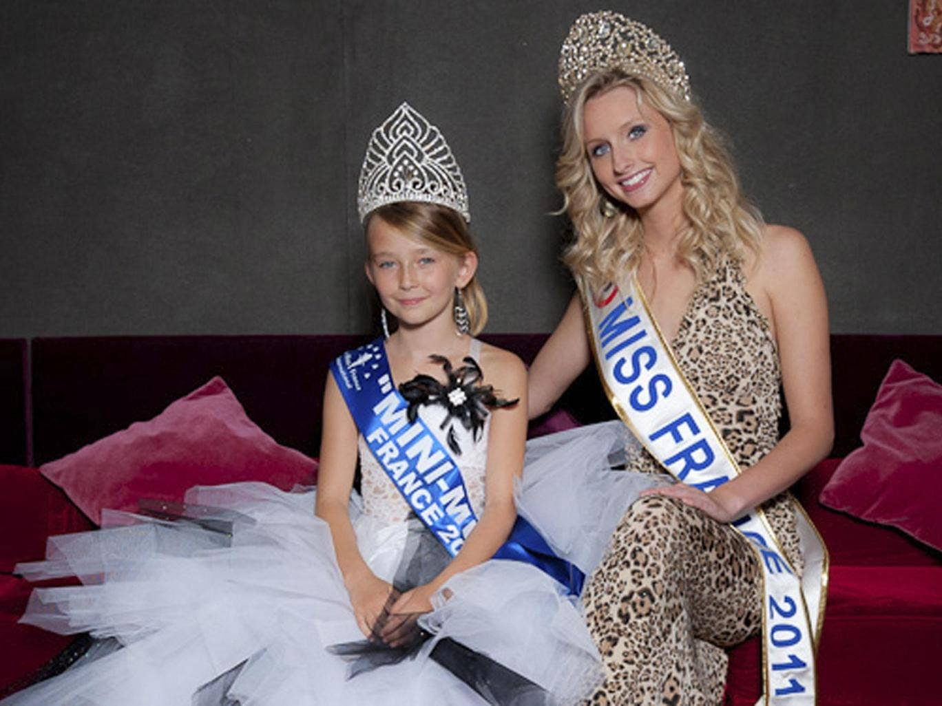 Oceane Scharre, 10, elected Mini Miss France 2011 (left) and Miss France 2011 Mathilde Florin. France's Senate has voted to ban beauty pageants for children under 16, in an effort to protect children, especially girls from being sexualized too early.