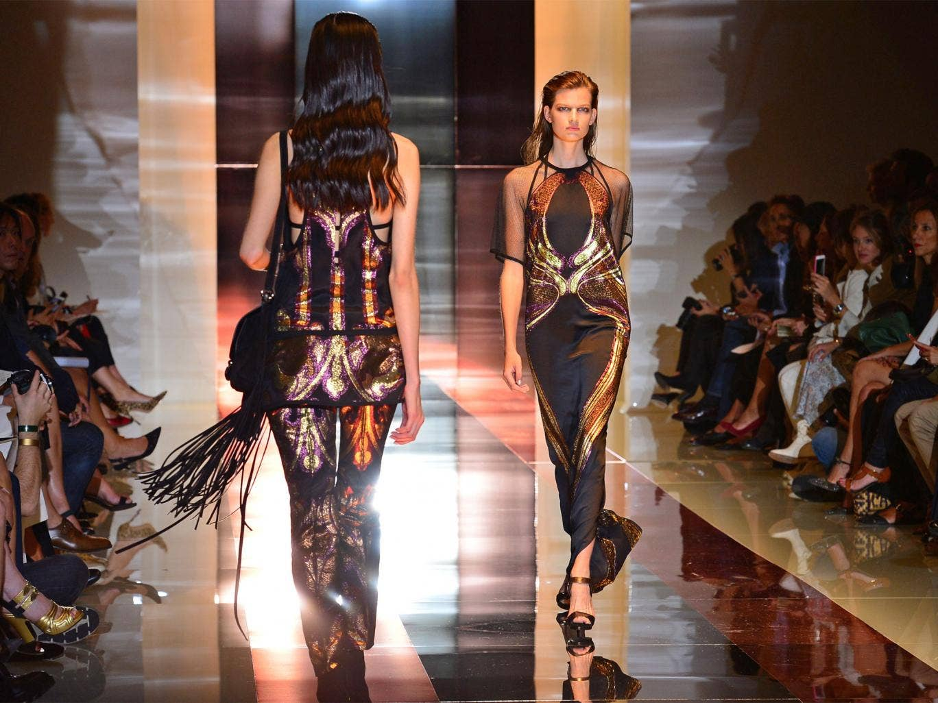 Models present creations for fashion house Gucci as part of the spring/summer 2014 ready-to-wear collections