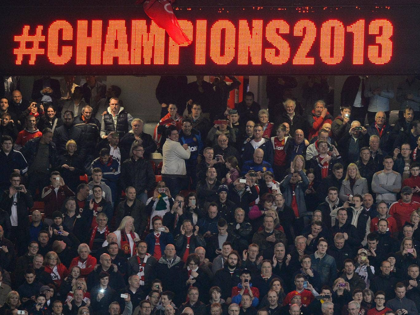 The Manchester United fans celebrate at Old Trafford