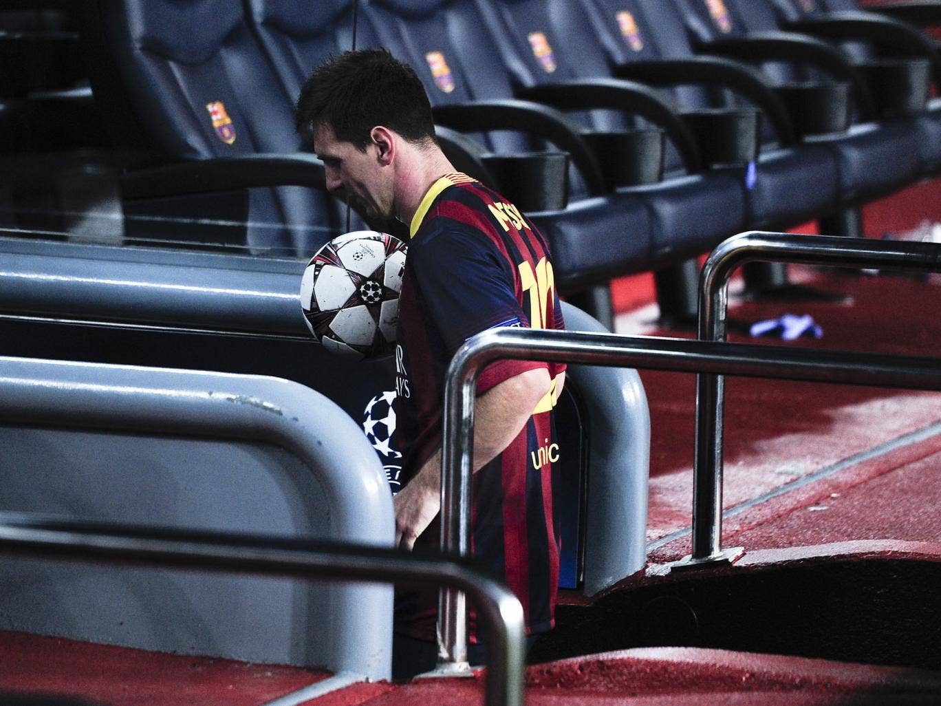 Lionel Messi leaves with the match ball after his hat-trick against Ajax