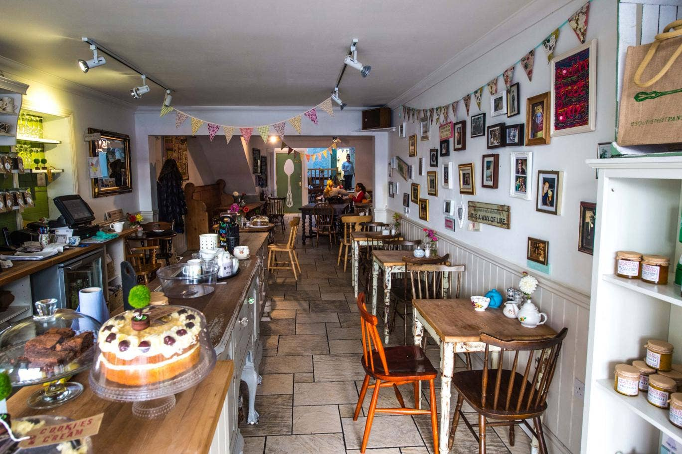Jaunty: The South Street Pantry features mismatched furniture and a counter laden with cakes
