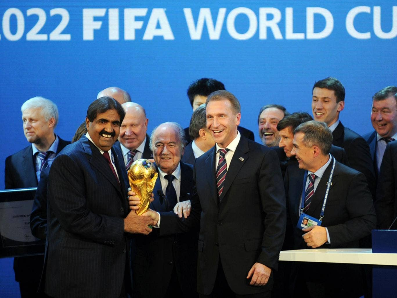 Emir of the State of Qatar Sheikh Hamad bin Khalifa Al-Thani (left) and Fifa President Sepp Blatter pose with the World Cup after the Qatar announcement in 2010