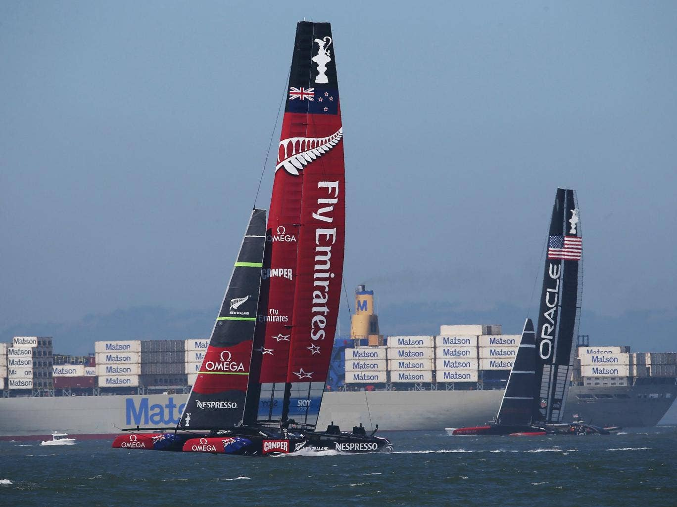 Oracle Team USA skippered James Spithill (R) in action against Emirates Team New Zealand skippered Dean Barker (L) during race twelve of the America's Cup finals