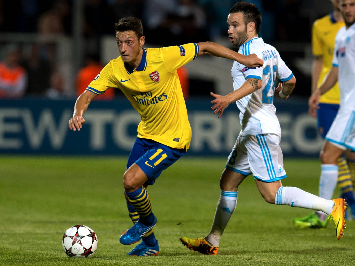 Mesut Ozil in action for Arsenal against Marseille