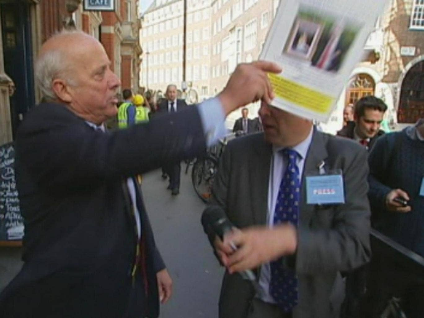 Bloom branded Crick 'disgraceful' before hitting him over the head with the brochure and throwing it to the floor