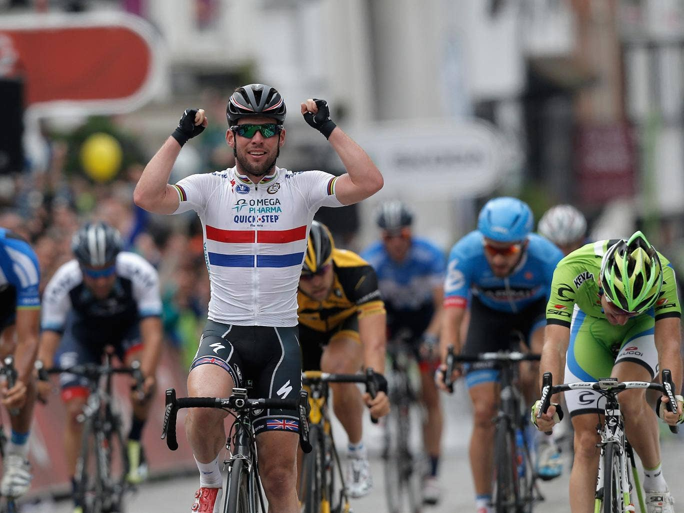 Mark Cavendish celebrates as he crosses the finish line on Stage Seven of the Tour of Britain