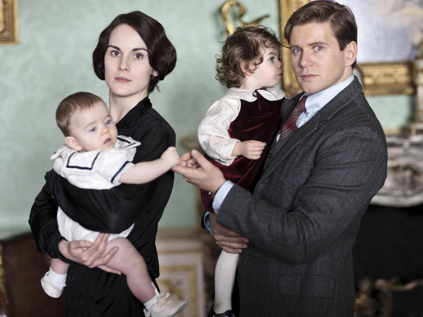 Posh parents: Downton Abbey's Lady Mary with baby George, and Tom Branson with Sybbie