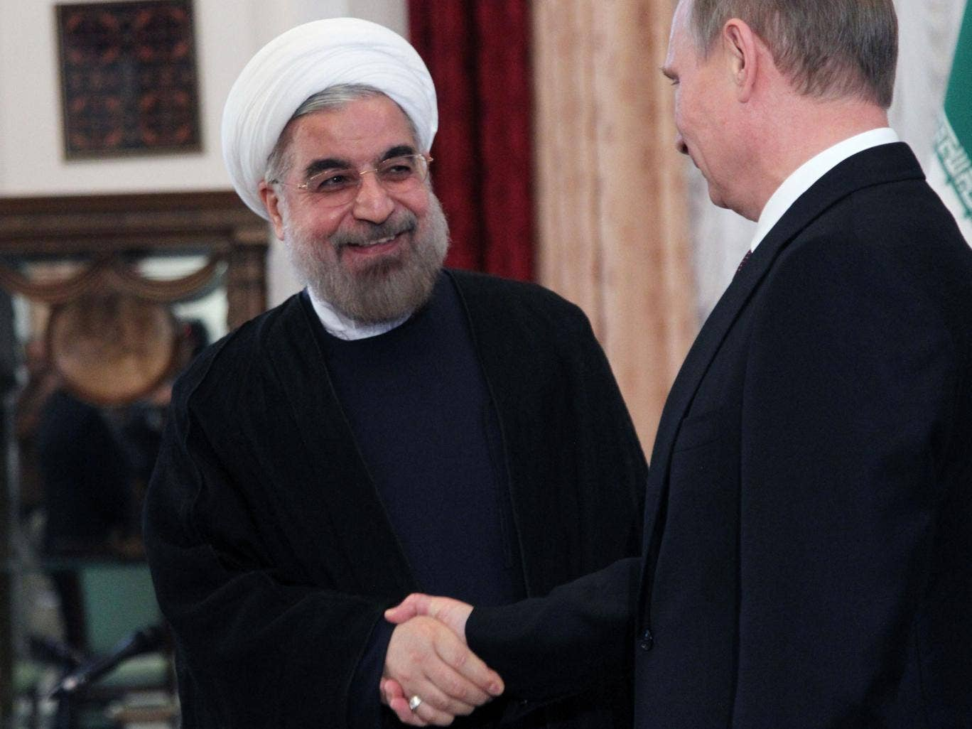 Firm friends: Mollifying words from Presidents Hassan Rouhani, and Vladimir Putin have not changed matters in Syria