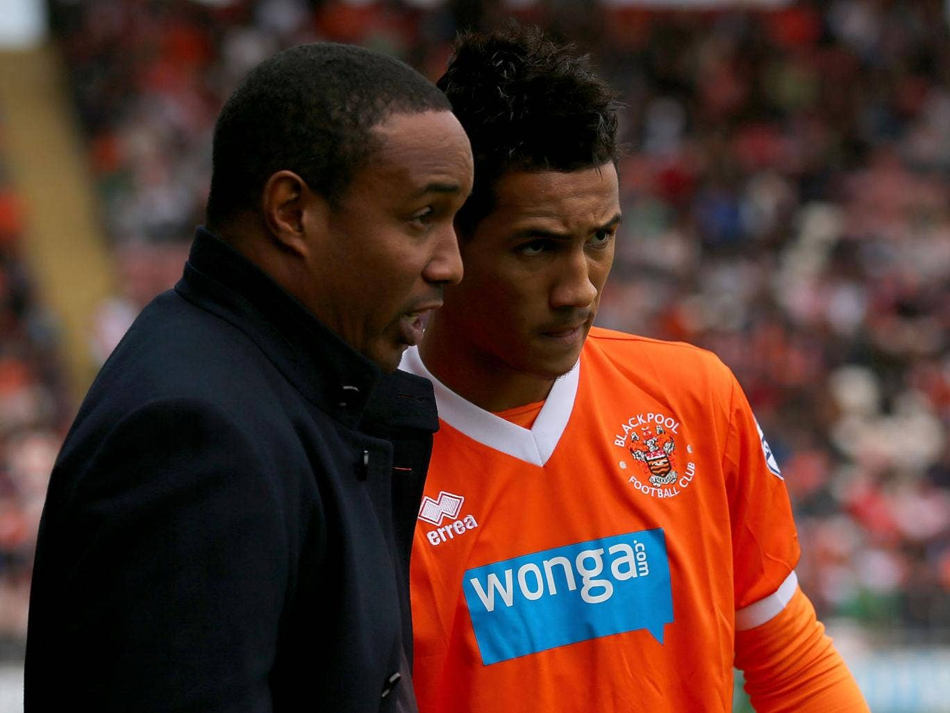 Family affair: Manager Paul Ince has a word with son Tom yesterday