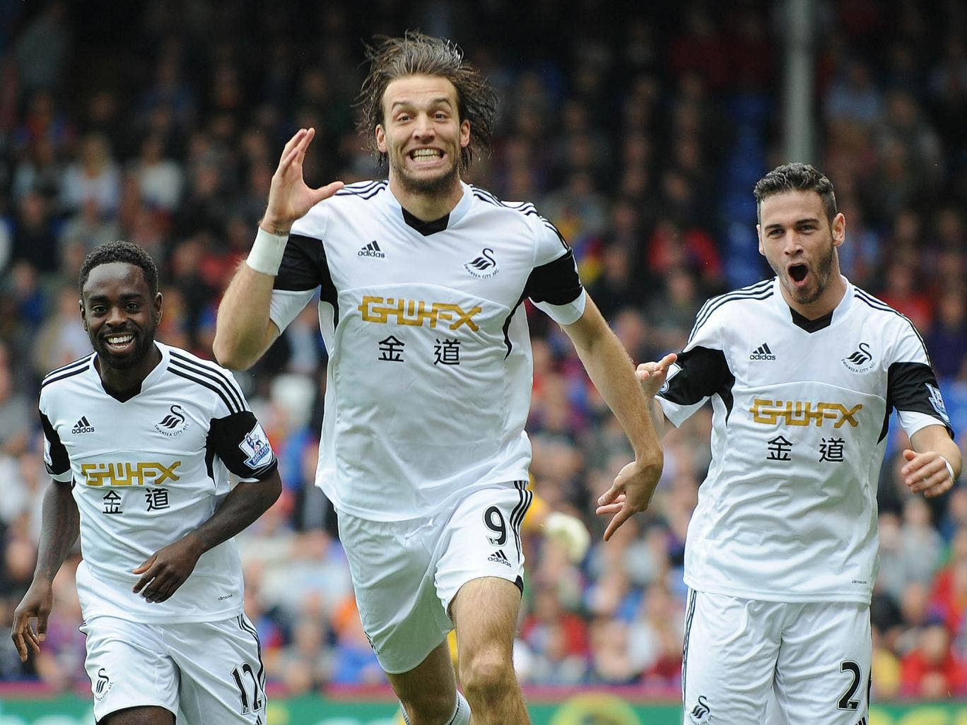 Michu celebrates after scoring for Swansea against Crystal Palace