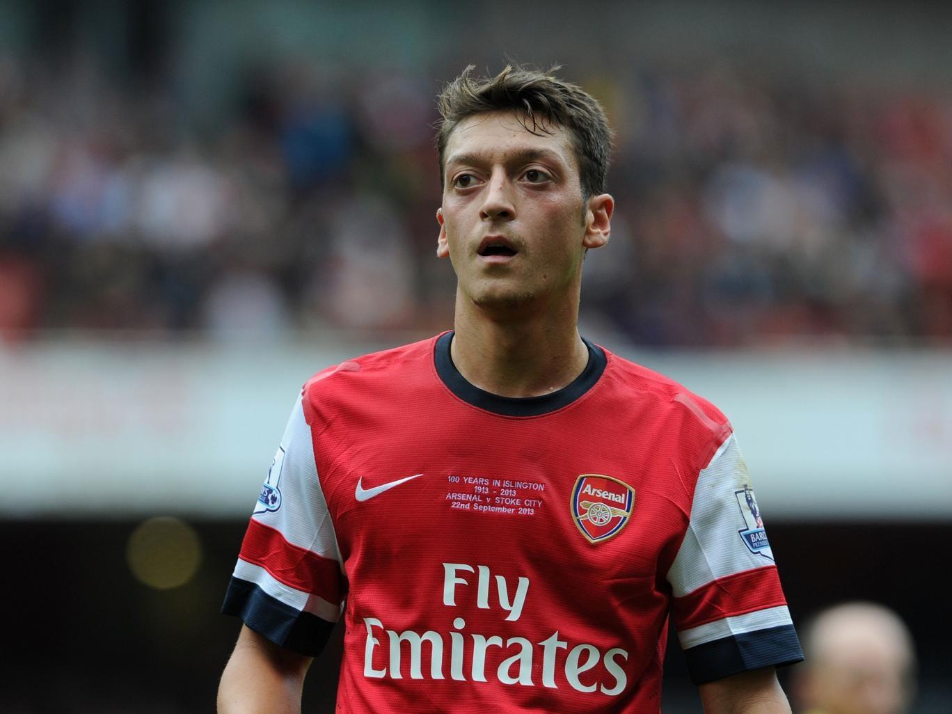 Arsene Wenger has praised midfielder Mesut Ozil for his performance against Stoke