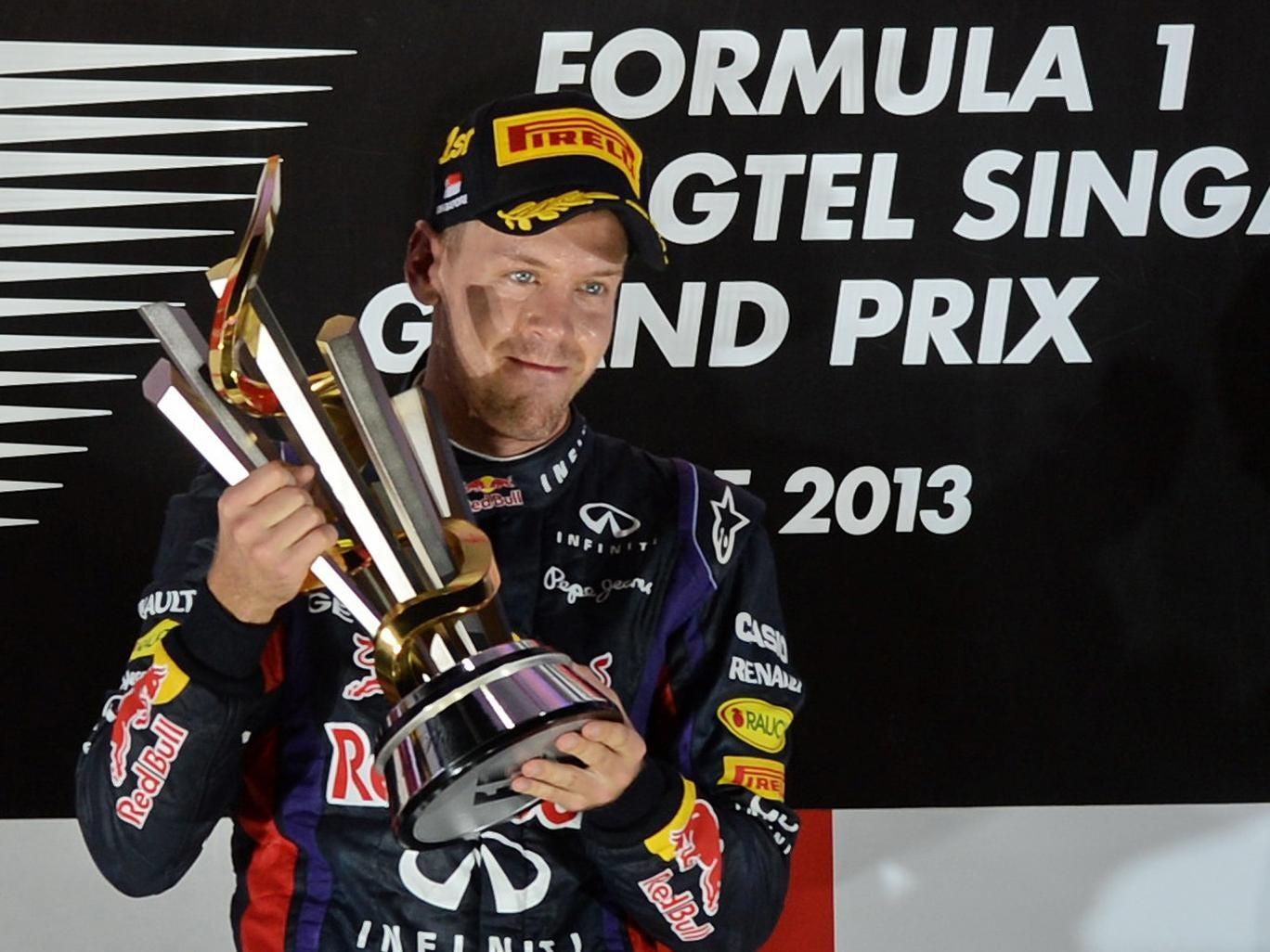 Sebastian Vettel celebrates his victory at the Singapore Grand Prix