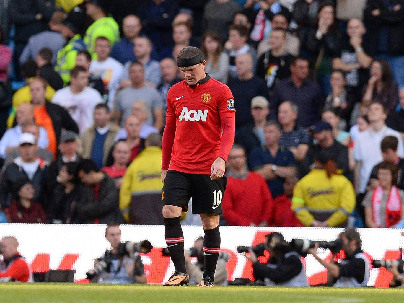 Wayne Rooney cut a dejected figure despite scoring to become the leading goalscorer in the Manchester derby