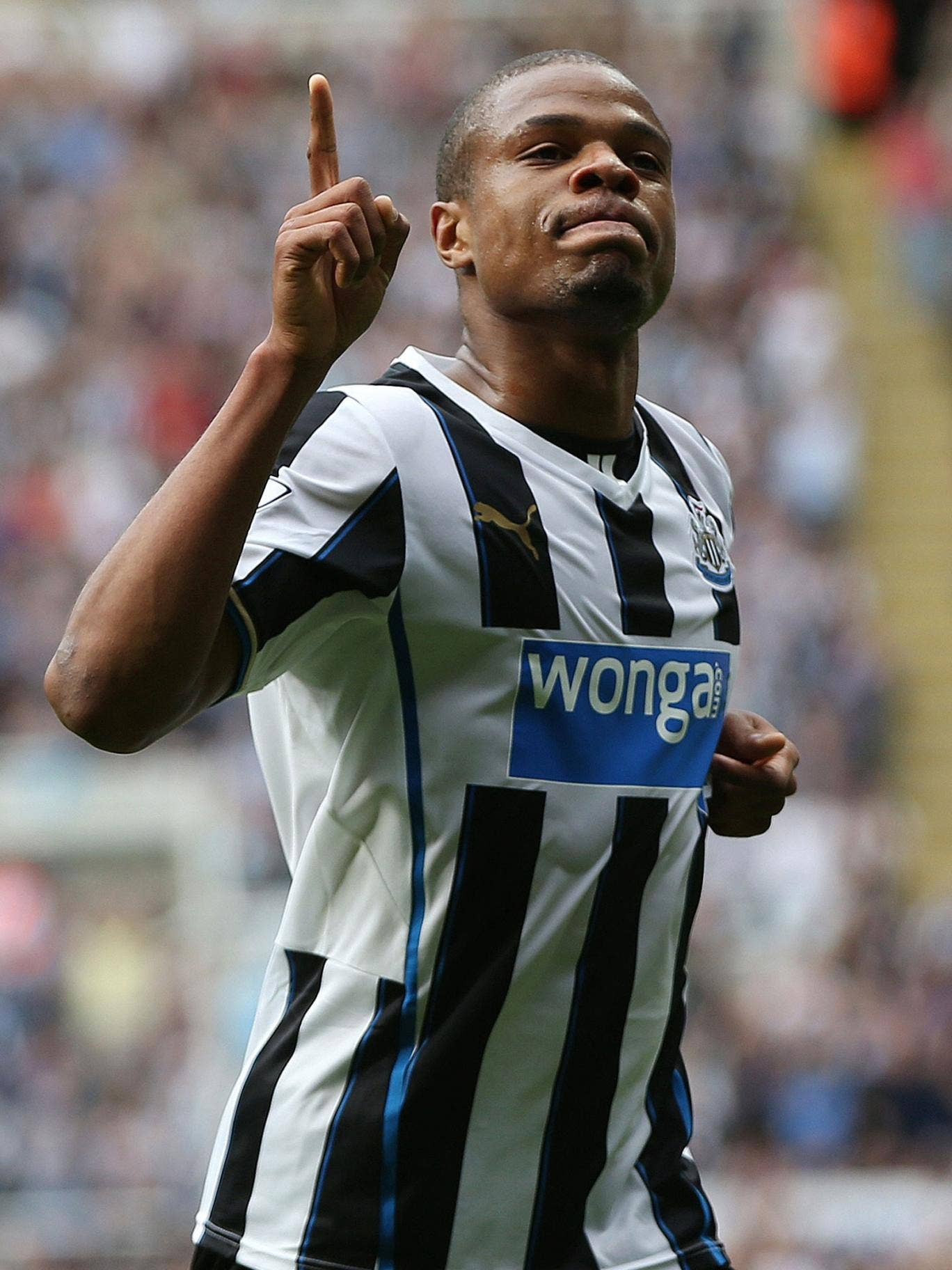 Loïc Rémy celebrates one of his two goals for Newcastle