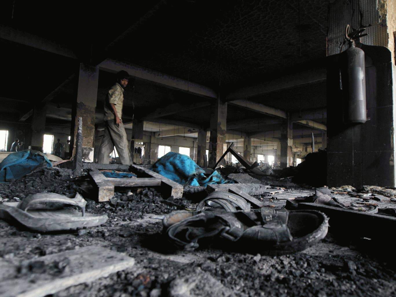 The charred remains of the Tazreen Fashion factory after a fire last November that killed 110 workers. It is claimed that factory managers had prevented employees from escaping the blaze.