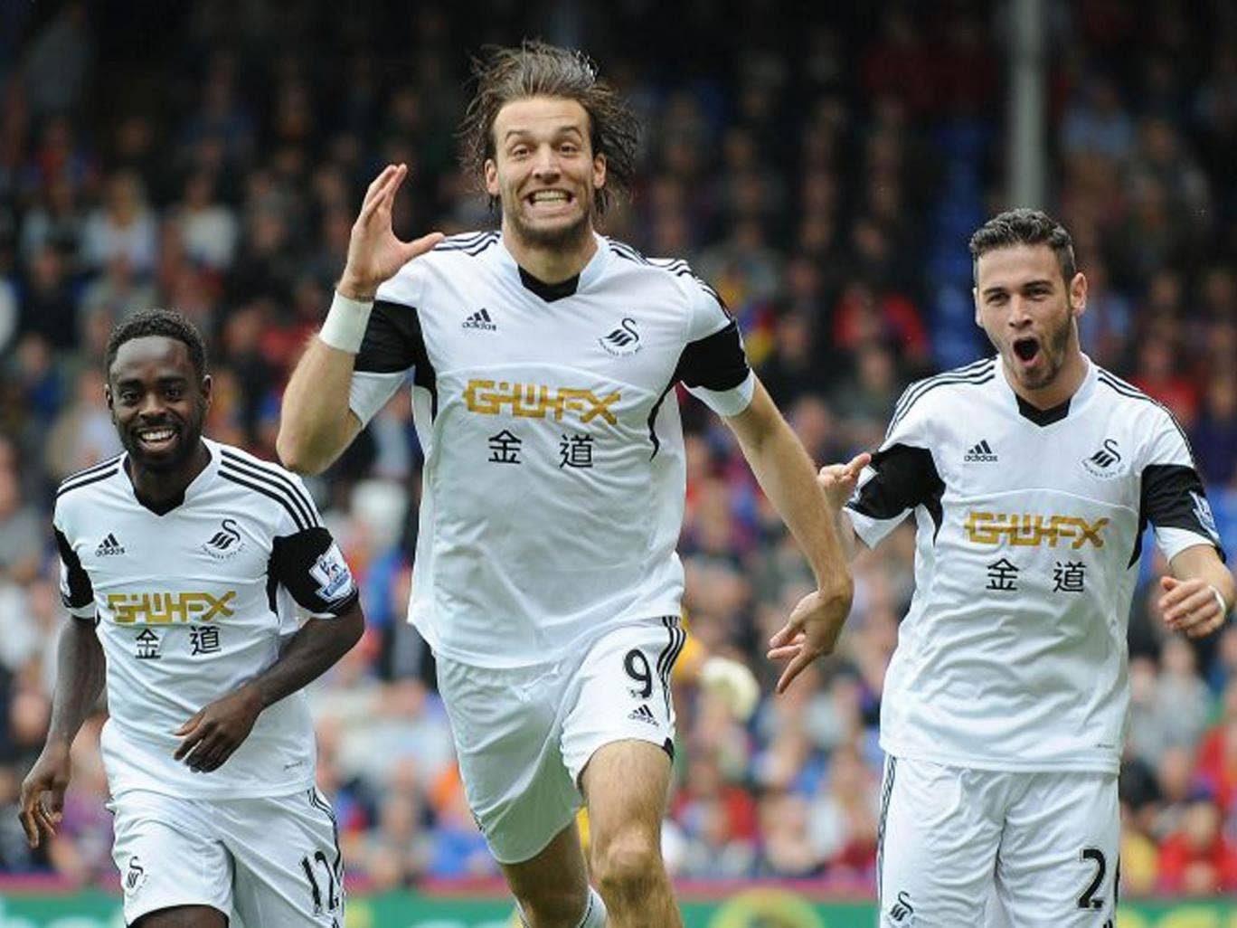 Michu, centre, was on target again to set up Swansea's win at Crystal Palace