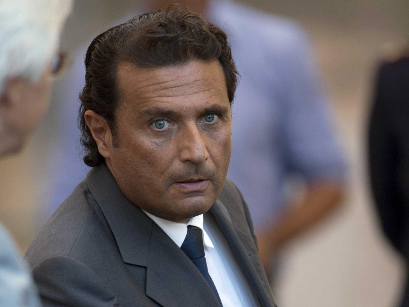 Captain Francesco Schettino leaves the court room