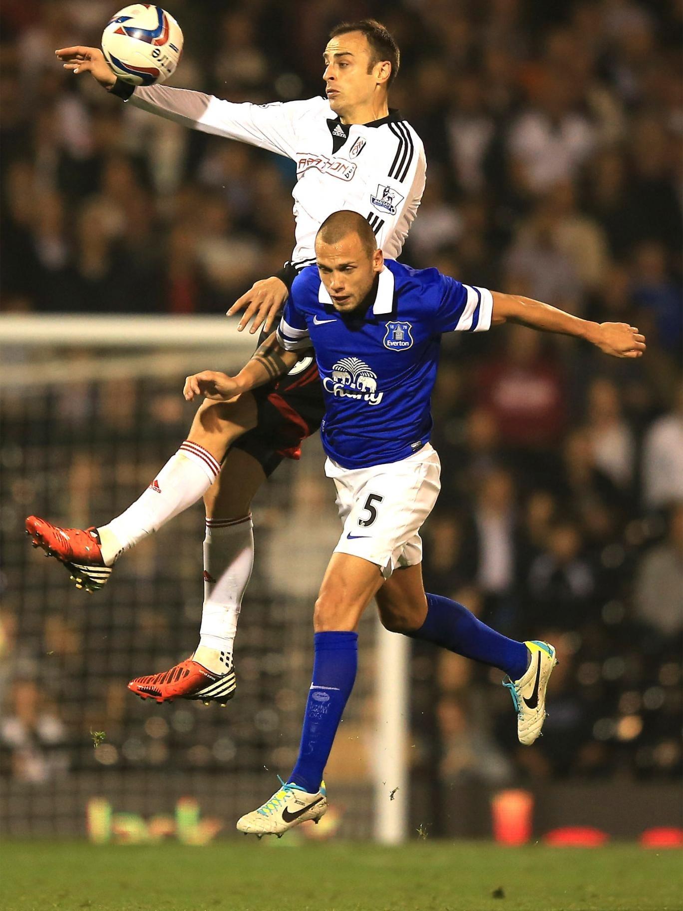 Dimitar Berbatov of Fulham rises above Everton's John Heitinga