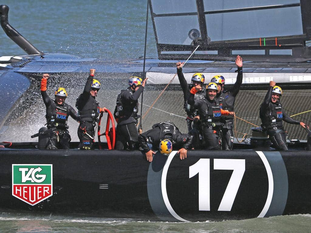Oracle Team USA celebrate retaining the America's Cup
