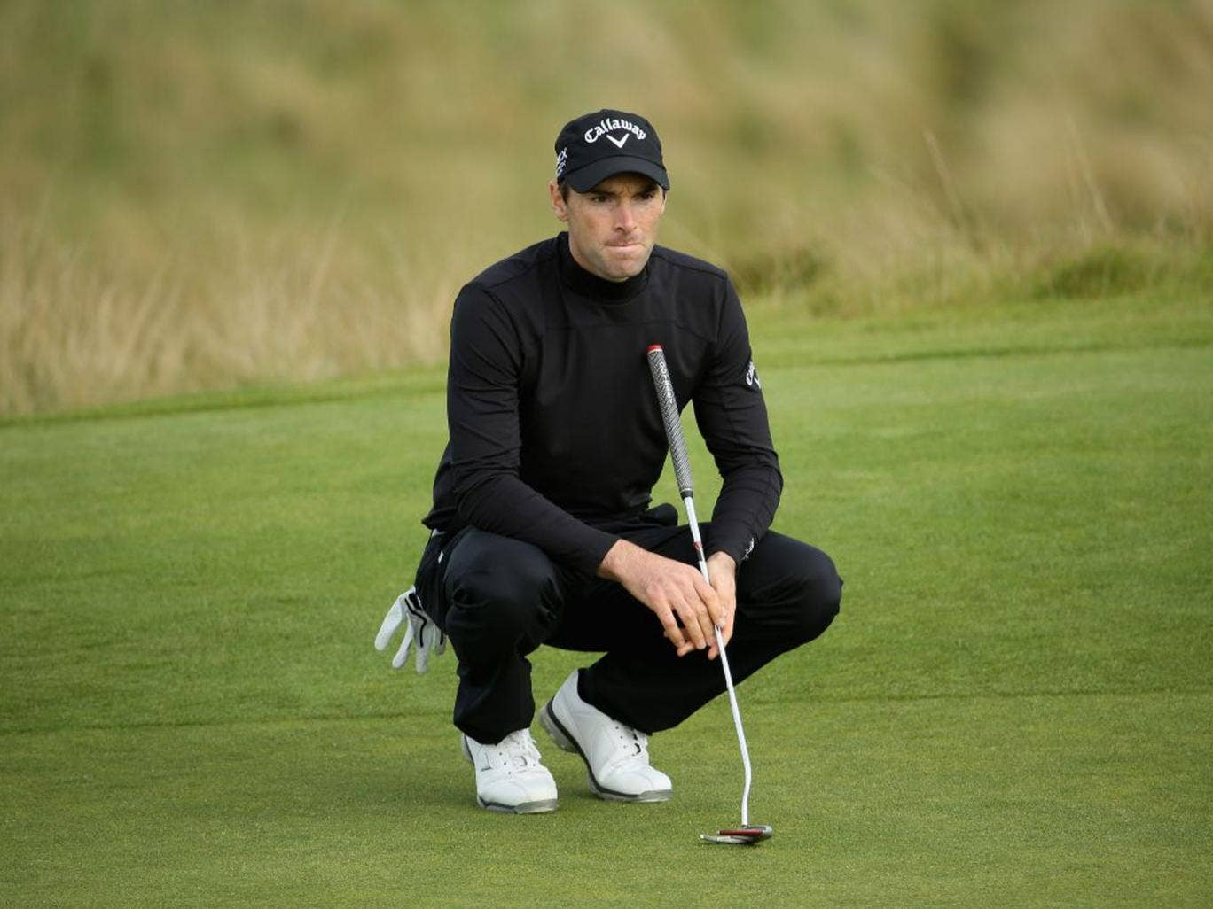 Oliver Wilson lines up at putt during yesterday's round of 64