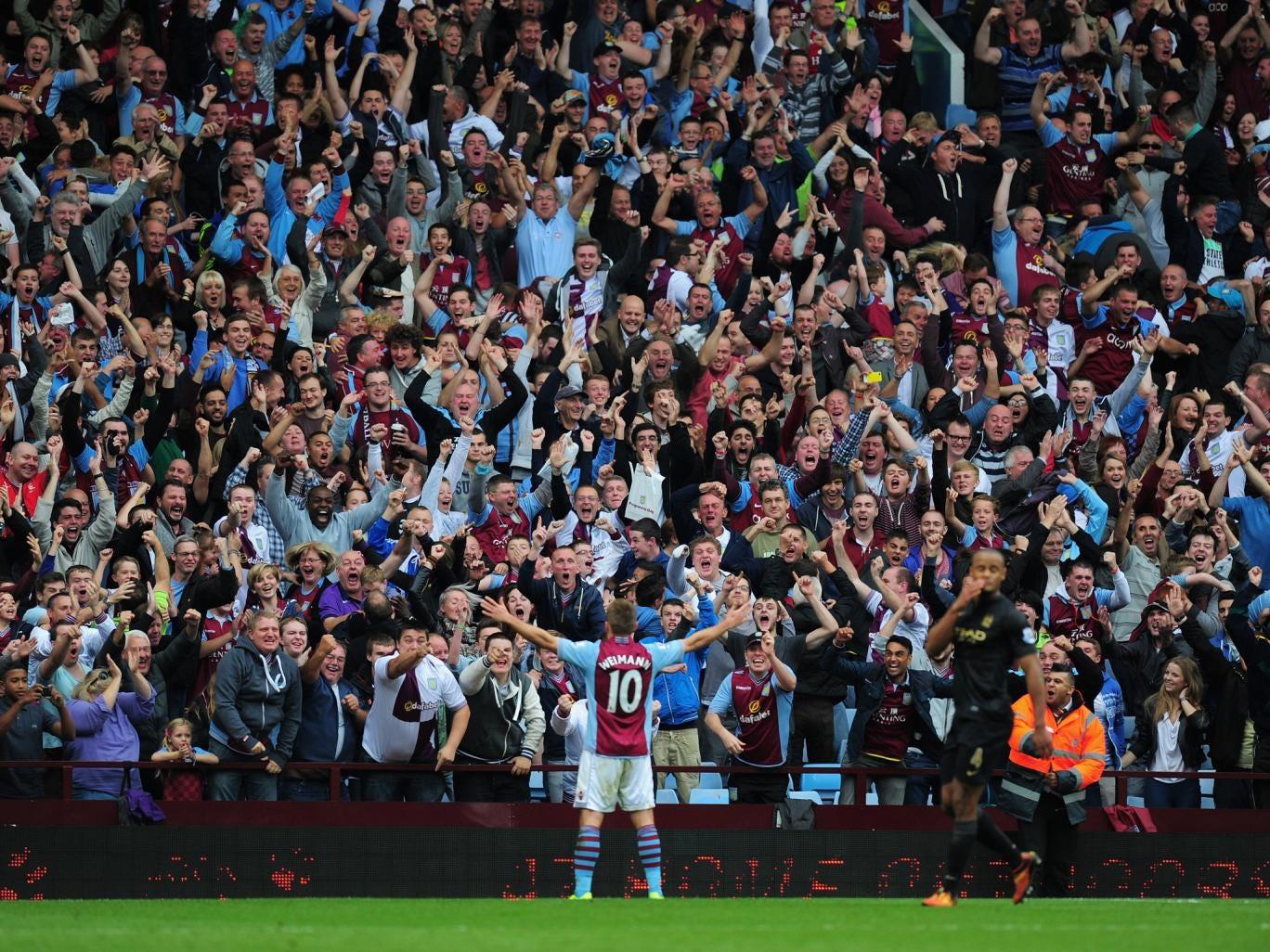 Andreas Weimann celebrates scoring the winner against Manchester City