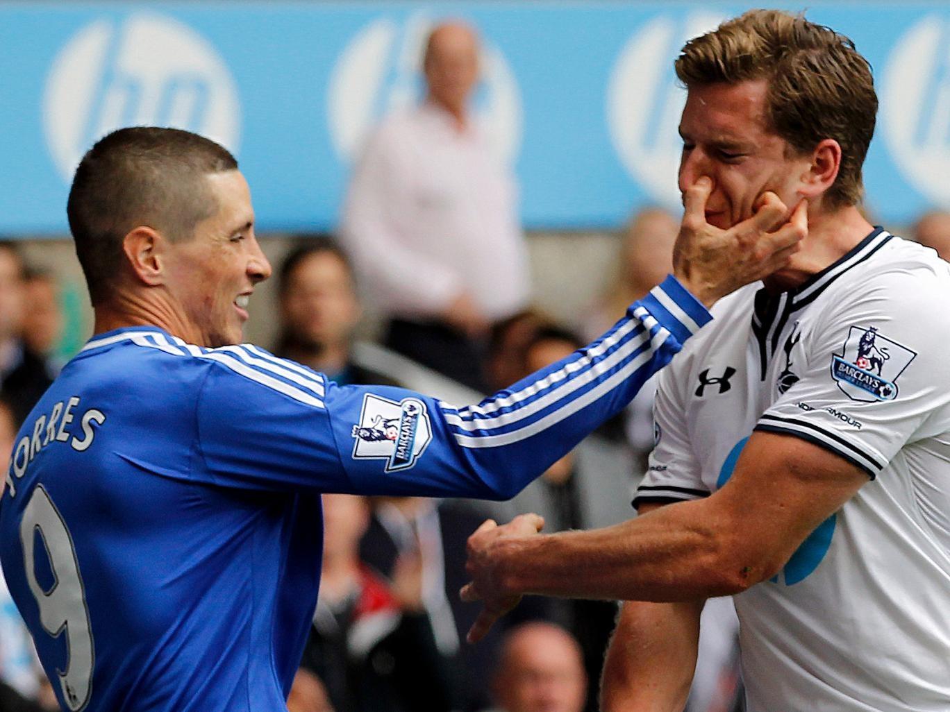 Chelsea's Fernando Torres clashes with Jan Vertonghen of Tottenham